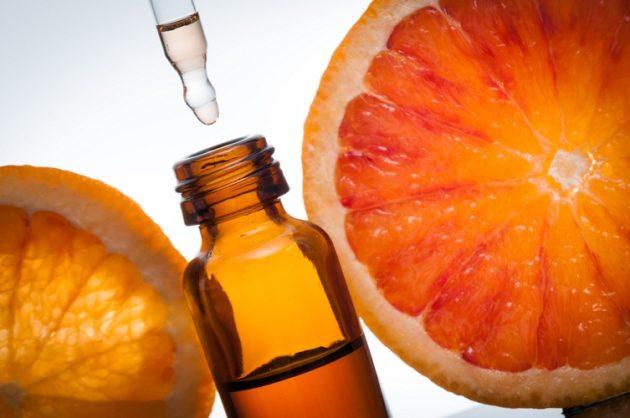 Флакон с эфирным маслом, грейпфрут и апельсин